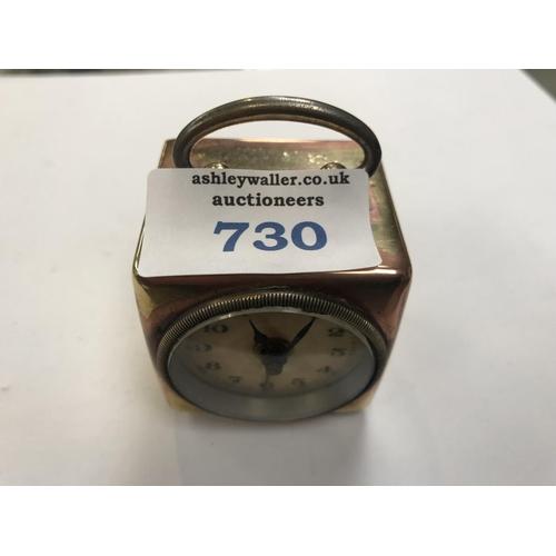 730 - A VINTAGE BRASS MINIATURE 'CUBE' BEDROOM CLOCK A/F...