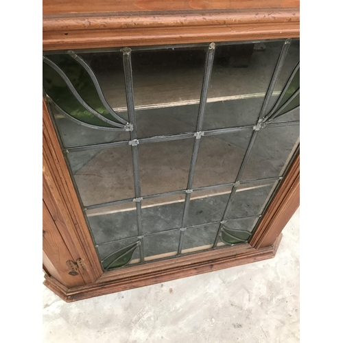 860 - A PINE FLAT FRONT CORNER CUPBOARD WITH SINGLE LEAD GLAZED DOORS...