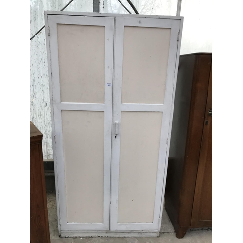 861 - A TALL PAINTED TWO DOOR CUPBOARD...