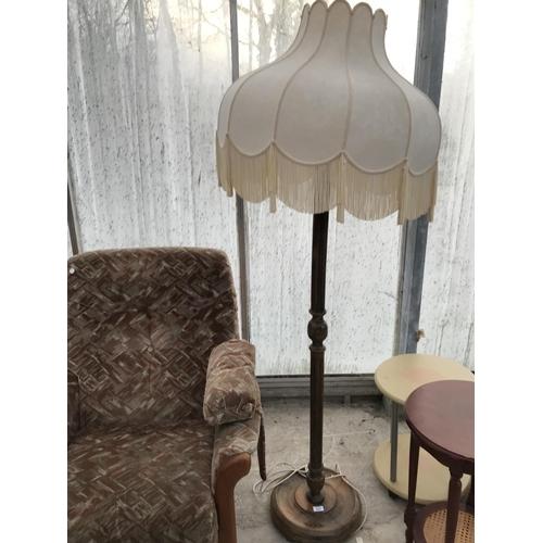 867 - AN OAK STANDARD LAMP...