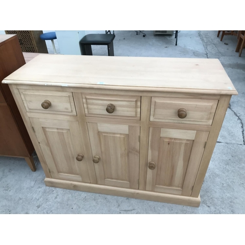 902 - A PINE SIDEBOARD WITH THREE DOORS AND THREE DRAWERS...