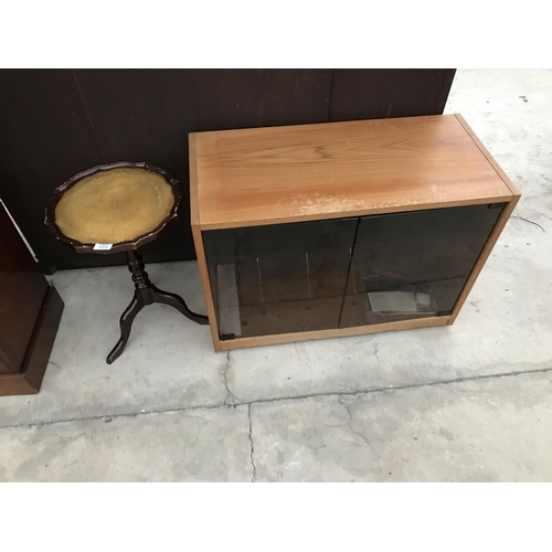919 - A TEAK CABINET AND A MAHOGANY WINE TABLE...