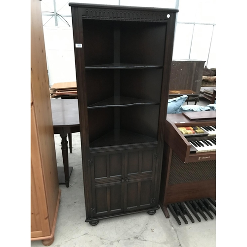 969 - A PRIORY STYLE OAK CORNER CUPBOARD  WITH TWO DOORS AND UPPER SHELVING...