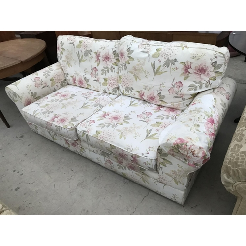 978 - A FLORAL TWO SEATER SOFA...