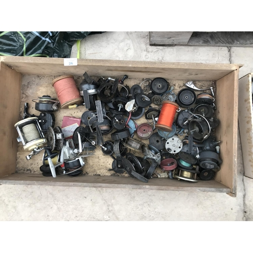 26 - A BOX CONTAINING VARIOUS REELS AND REEL PARTS...