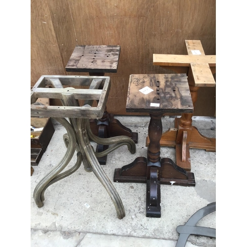 14 - FOUR WOODEN TABLE BASES...