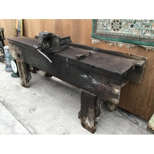 27 - A VINTAGE PINE WORK BENCH WITH LARGE BENCH VICE...