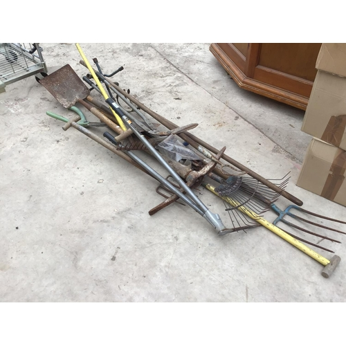 38 - A LARGE GROUP OF ASSORTED GARDEN TOOLS, RAKES, PICK ETC...
