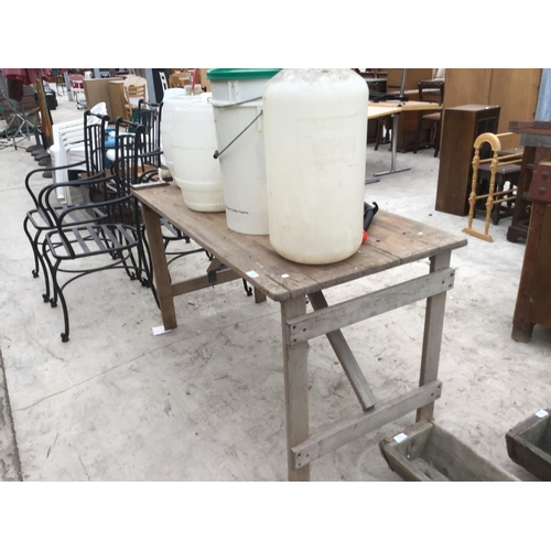 43 - A VINTAGE WOODEN TRESTLE TABLE WITH VARIOUS PLASTIC BREWING BUCKETS AND BARRELS...