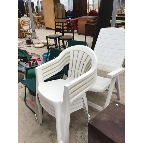 46 - FOUR WHITE PLASTIC GARDEN CHAIRS, A WHITE PLASTIC RECLINING CHAIR AND TWO FOLD UP DECK CHAIRS ETC...