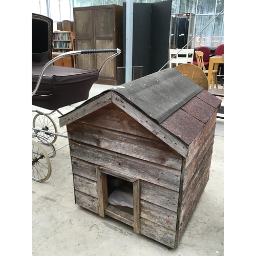 52 - A WOODEN DOG KENNEL...