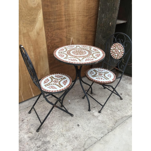 8 - A DECORATIVE BISTRO TABLE AND TWO CHAIRS SET...