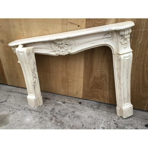 9 - A DECORATIVE MARBLE EFFECT FIRE PLACE SURROUND...