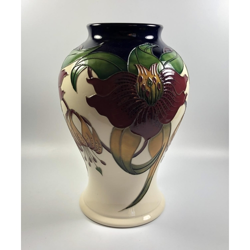 506 - A MOORCROFT POTTERY 'ANNA LILY' PATTERN VASE, HEIGHT 23.5CM...