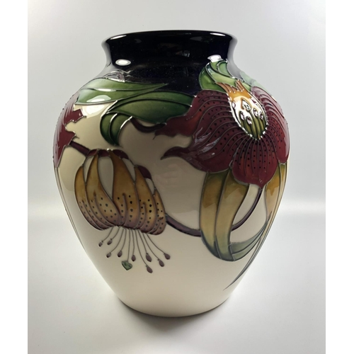 523 - A MOORCROFT POTTERY 'ANNA LILY' PATTERN VASE, HEIGHT 21CM...