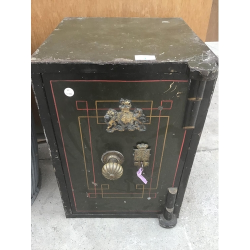 1 - A ORNATE CAST IRON SAFE WITH KEY W35.5CM X H51CM X D36CM...