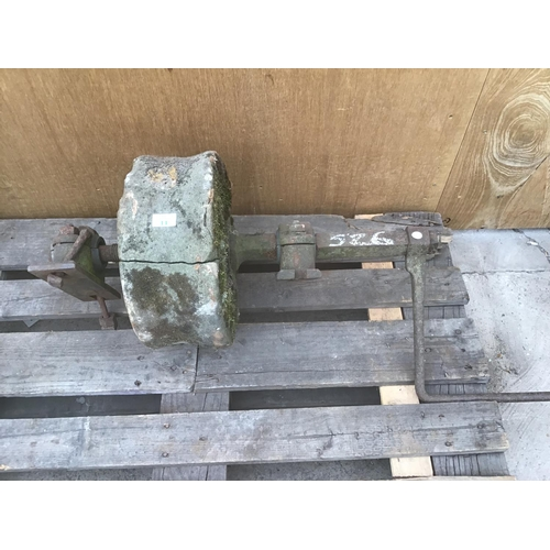 11 - A SANDSTONE GRINDING WHEEL ON A SHAFT WITH TURNING HANDLE...