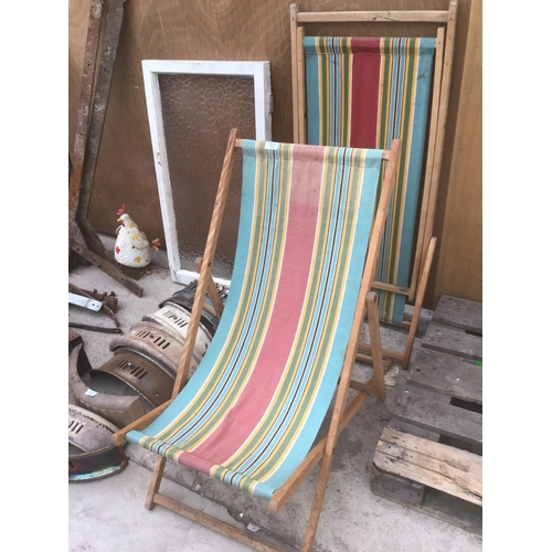 12 - TWO VINTAGE WOODEN FRAMED FOLDING DECK CHAIRS WITH STRIPED CANVAS...
