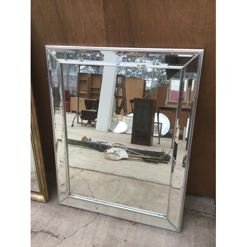 17 - A LARGE MIRROR WITH MIRRORED FRAME...