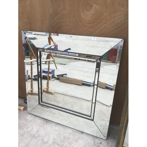 19 - A LARGE SQUARE MIRROR WITH MIRRORED FRAME (SLIGHT DISCOLOURATION TO RH CORNER - SEE PICTURE)...