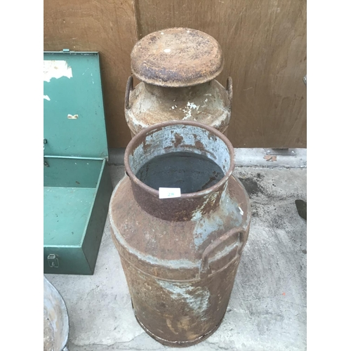28 - A PAIR OF VINTAGE MILK CHURNS (ONE WITH CORROSION TO THE BASE)...