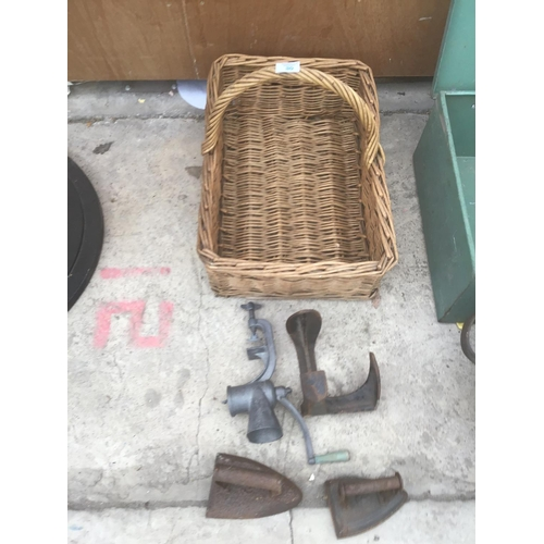 30 - A VINTAGE WICKER PICNIC BASKET,TWO IRONS,A SHOE LAST AND A MINCER...