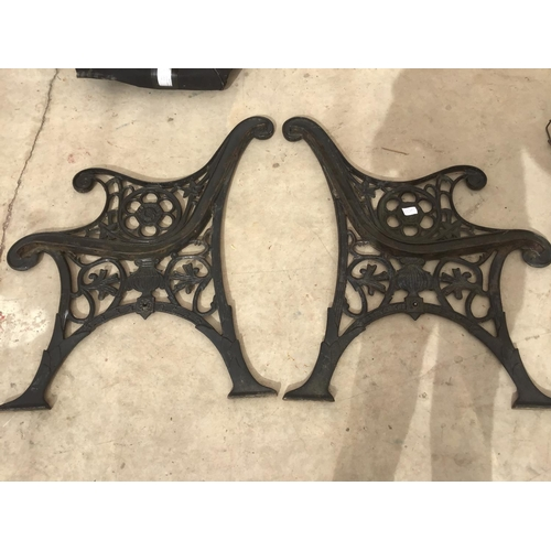 38 - A PAIR OF ORNATE CAST IRON BENCH ENDS...