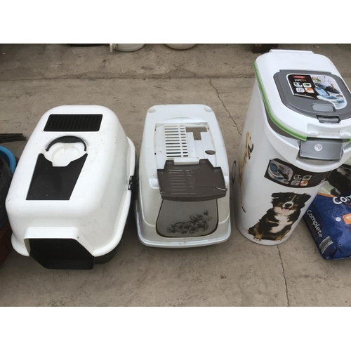 45 - A LARGE COLLECTION OF PET ITEMS TO INCLUDE PET CARRIERS, TOYS, BOWLS, STORAGE BINS, AND DRY DOG FEED...