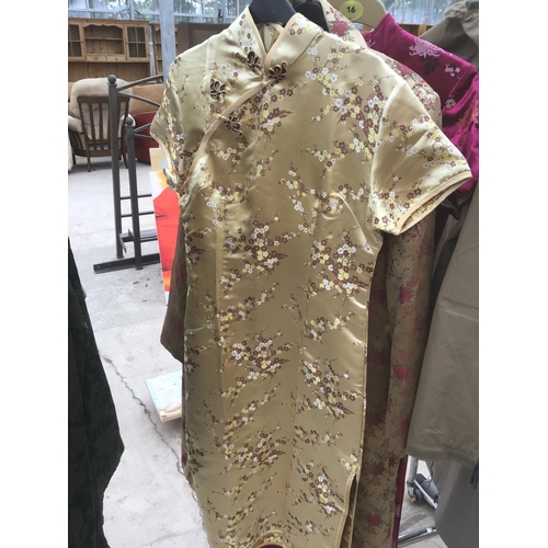 54 - A COLLECTION OF CHINESE STYLE CLOTHING TO INCLUDE THREE DRESSES, A COAT, PYJAMAS AND A 100% SILK MAD...