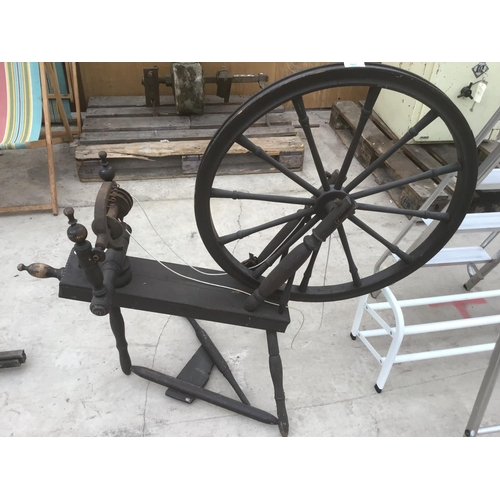 56 - A VINTAGE SPINNING WHEEL...