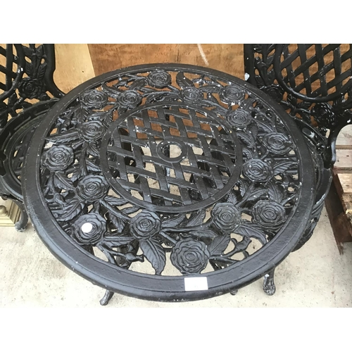 6 - A HEAVY CAST IRON ROSE DESIGN TABLE WITH TWO MATCHING CHAIRS...