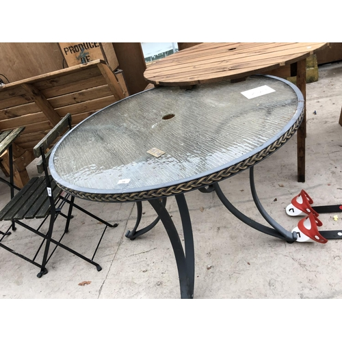 94 - A CIRCULAR TOPPED TABLE AND FURTHER GARDEN TABLE AND CHAIR SET...