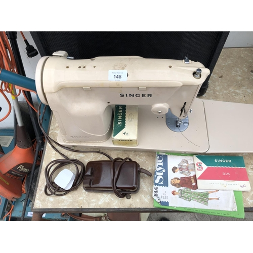 148 - A SINGER SEWING MACHINE WITH PEDAL ETC IN WORKING ORDER...
