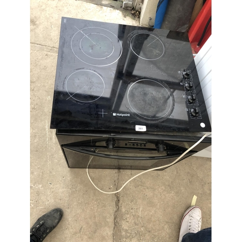 261 - A CERAMIC HOTPOINT HOB TOP TOGETHER WITH OVEN IN WORKING ORDER...