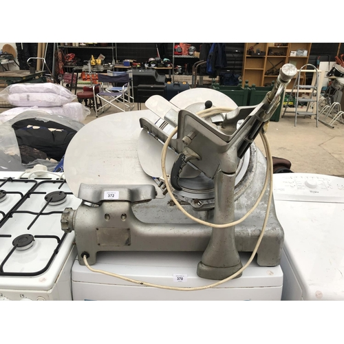 372 - A STAINLESS STEEL MEAT SLICER IN WORKING ORDER...