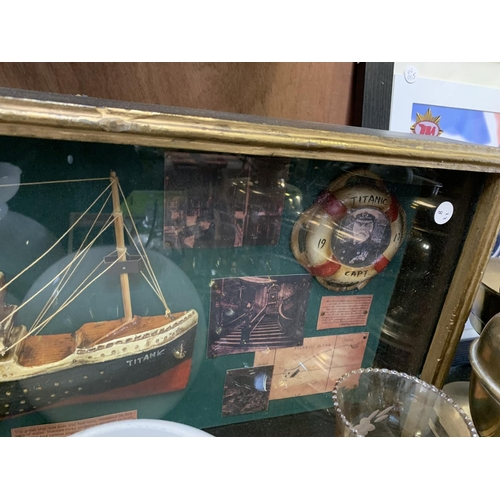 447 - A TITANIC MODEL AND OTHER MEMORABILIA IN GLASS CASE...