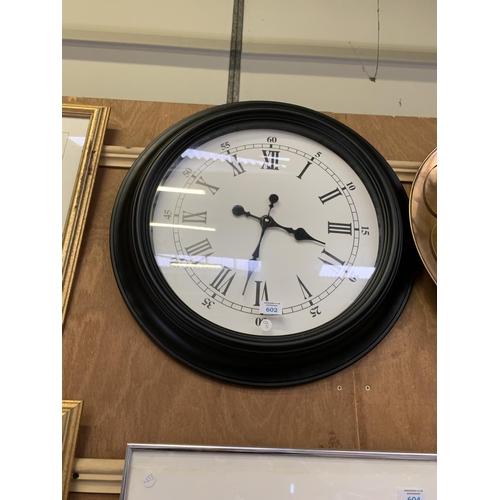 602 - A LARGE MODERN WALL CLOCK...