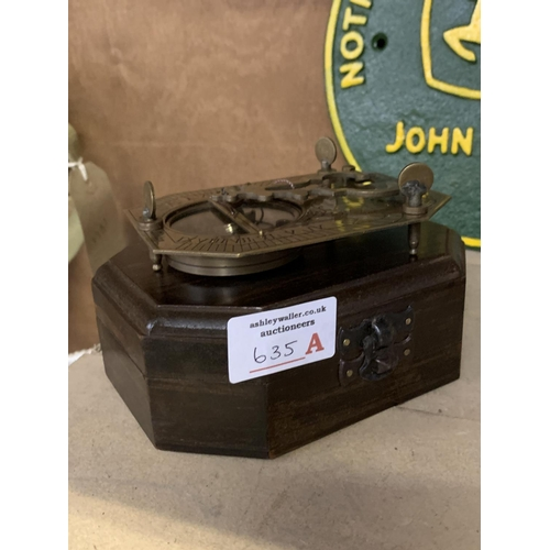 635A - A BOXED BRASS SUNDIAL AND COMPASS COX LONDON...