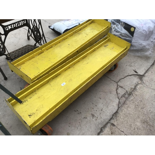 49 - A PAIR OF IRON FOUR WHEELED TROLLEYS 127CM X 30CM...