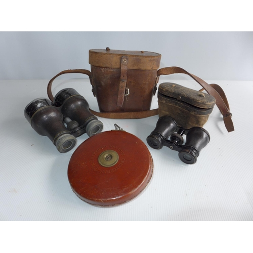 364 - A CASED PAIR OF BINOCULARS, CASED PAIR OF OPERA GLASSES AND A TAPE MEASURE...
