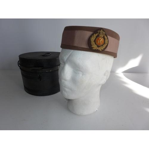 385 - A BELGIUM FEMALE MILITARY HAT IN A TIN CASE...