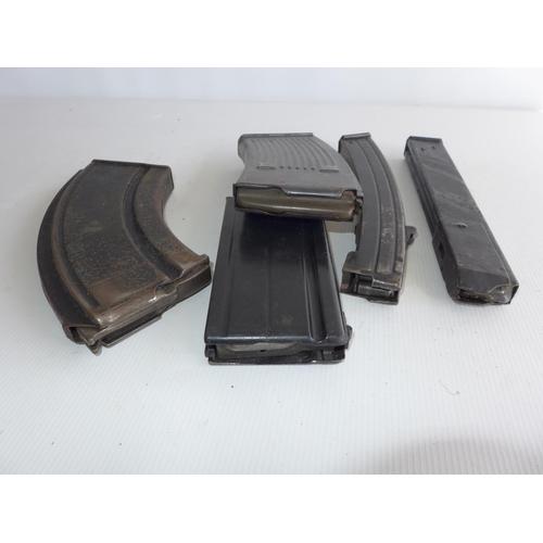386 - FIVE ASSORTED GUN MAGAZINES...