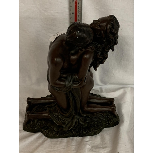 10 - A LARGE RESIN FIGURE OF A LOVING COUPLE...