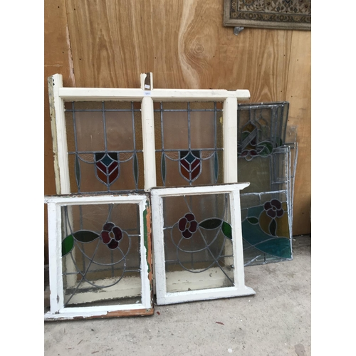 1012 - A QUANTITY OF LEAD GLASS WINDOW PANELS FRAMED AND UNFRAMED...