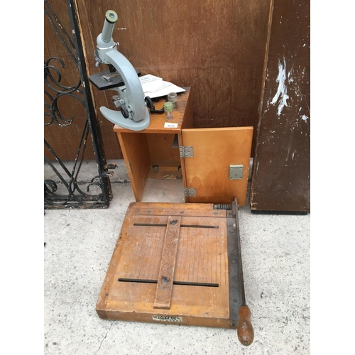 1016 - A VINTAGE MICROSCOPE IN A WOODEN CASE AND A DRYAD LEICESTER GUILLOTINE...