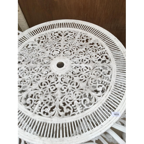 1033 - A WHITE PAINTED METAL GARDEN TABLE WITH FOUR ARM CHAIRS...