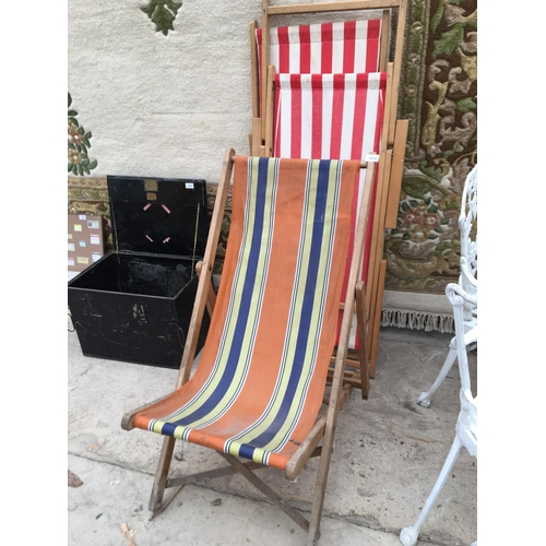 1034 - THREE VINTAGE STRIPED CANVAS WOODEN FRAMED DECK CHAIRS...
