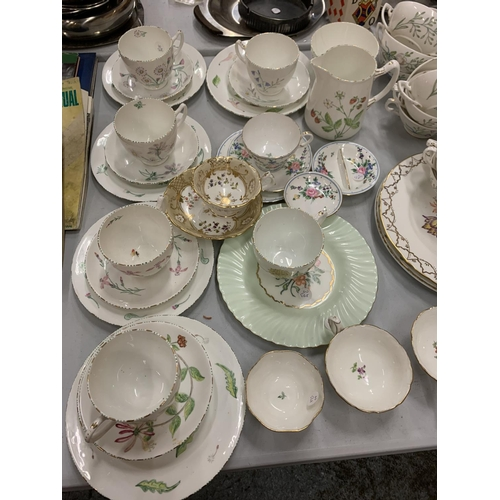 104 - AN EXTENSIVE COLLECTION OF FLORAL DECORATED TEA WARE INCLUDING CAKE STANDS...