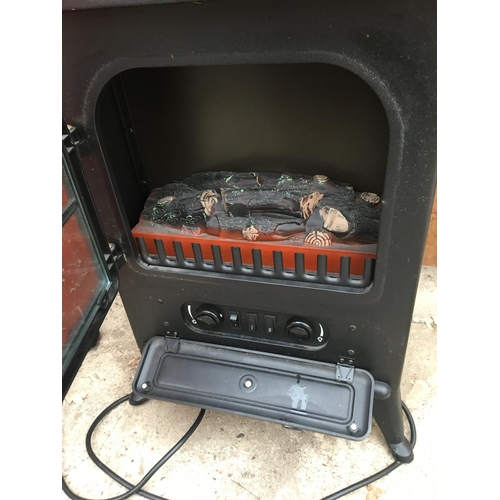 1040A - AN ELECTRIC WOOD BURNING STOVE STYLE HEATER...