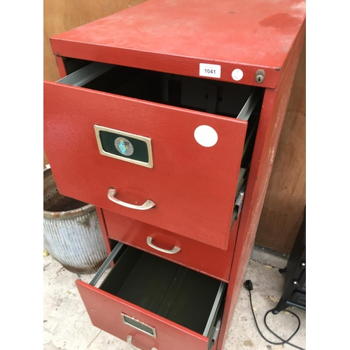 1041 - A FOUR DRAWER METAL FILING CABINET...